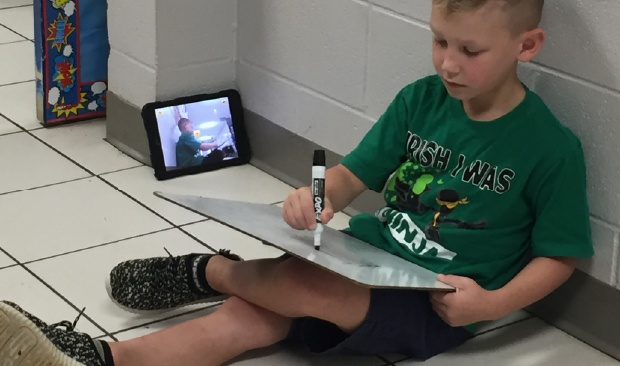 Student using eSpark to record a re-teaching video
