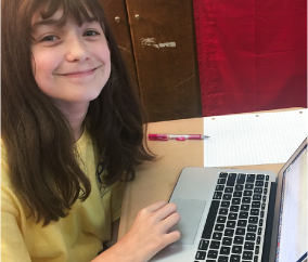 Happy 5th Grader using eSpark on a laptop