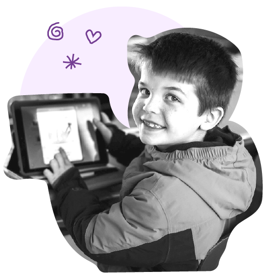 Smiling 2nd Grader using eSpark on an iPad